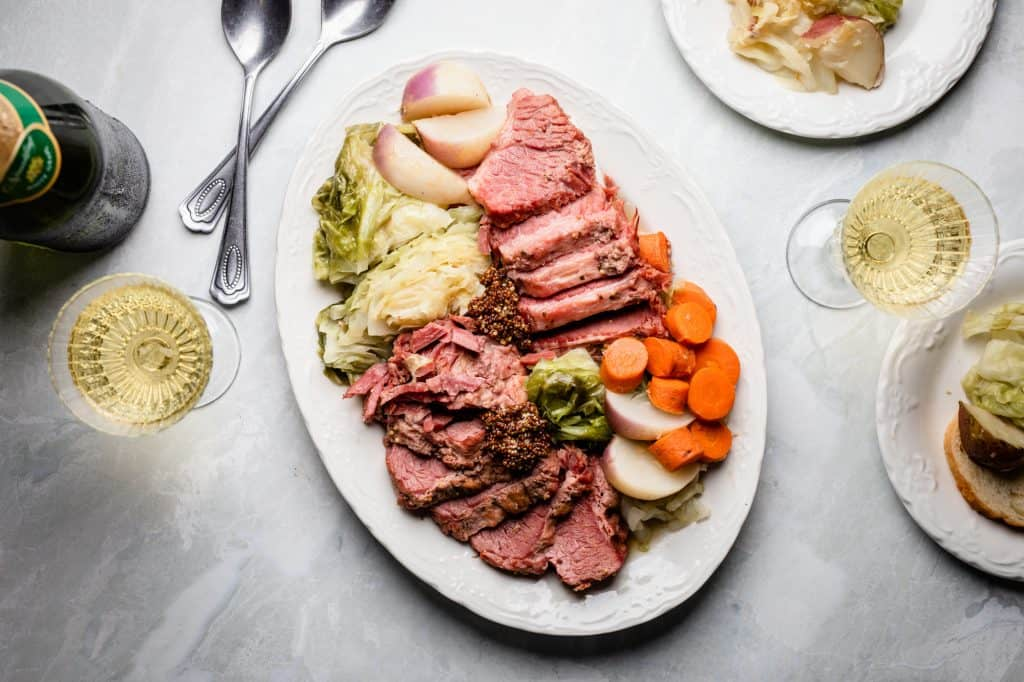 A dinner spread of corned beef and cabbage made in the instant pot