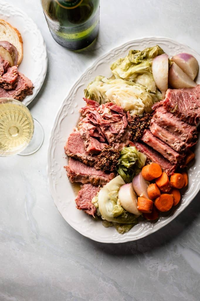 A platter of corned beef and cabbage with carrots and turnips