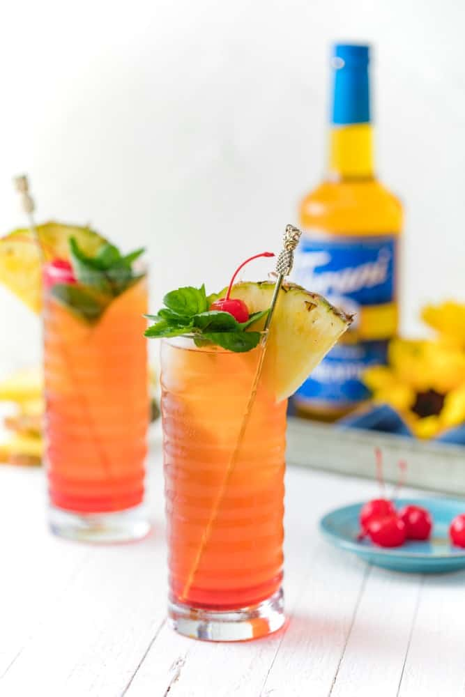 Pineapple Upside Down Iced Tea in two glasses with Torani Pineapple syrup