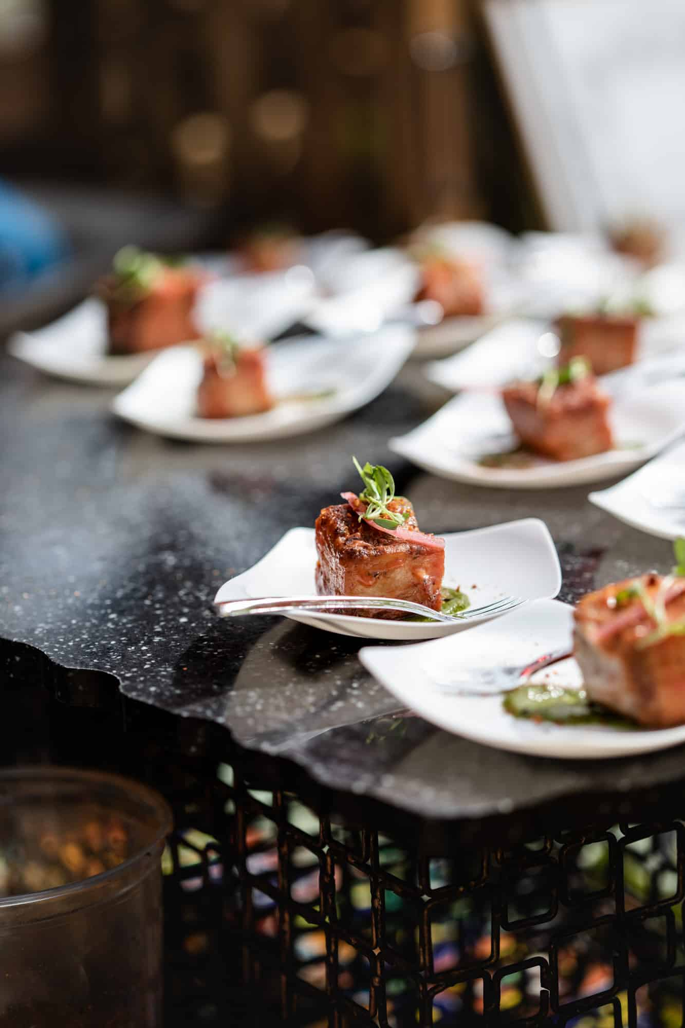 Crispy Pork Belly Bites on white plates