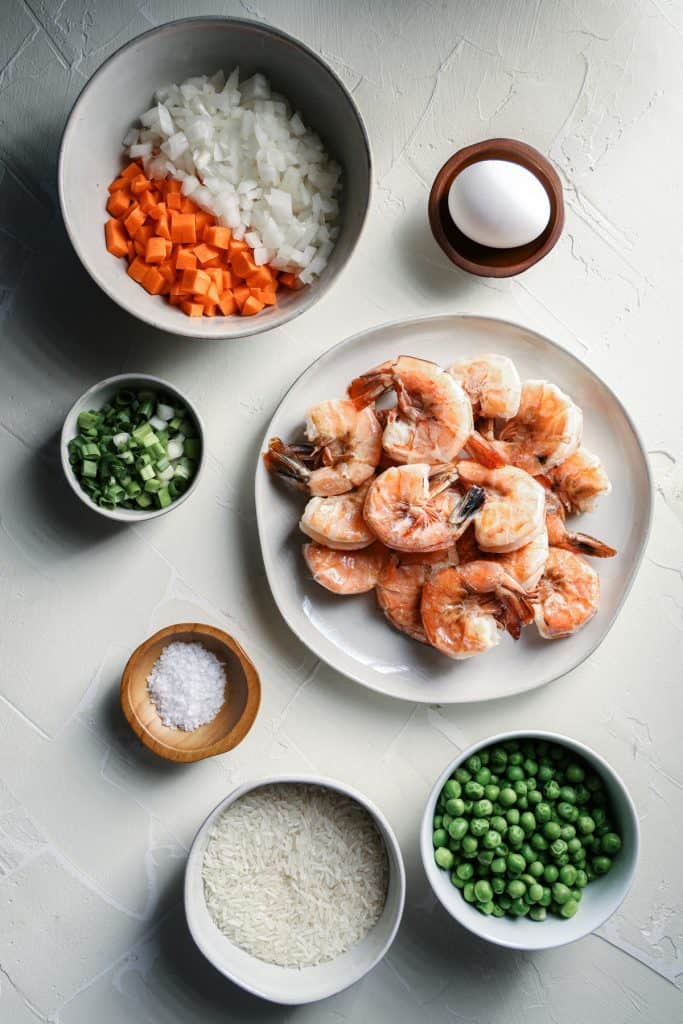 Overhead view of ingredients for shrimp fried rice