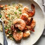 overhead view of a plate of shrimp with fried rice