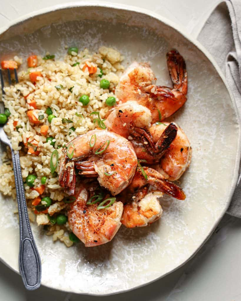 Overhead view of a plate with shrimp fried rice
